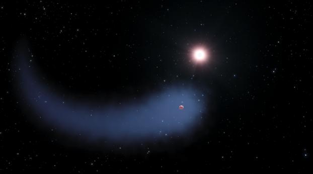 Vue d'artiste du nuage d'hydrogène géant entourant l'exoplanète de type Neptune-chaud GJ 436b.